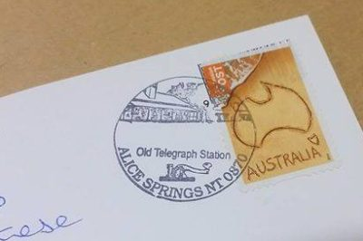 All mail posted onsite in the original red Postbox the first post box of Alice Springs), is stamped with the unique Commemorative Franking Stamp